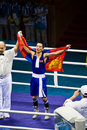 Boxer wears flag after winning gold Royalty Free Stock Photography