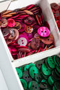 Boxes of colourful buttons full mother pearl in a variety colours Stock Photo