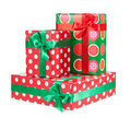 Boxes with gifts tied with red ribbon and bows isolated