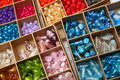 Boxes of jewellery beads closeup colorful in square Royalty Free Stock Photography