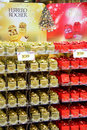 Boxes of mon cheri ferrero rocher red and chocolates for sale in a supermarket christmas display Royalty Free Stock Photo