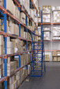 Boxes on shelves in warehouse cardboard distribution Royalty Free Stock Image