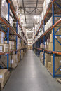 Boxes on shelves in warehouse cardboard distribution Royalty Free Stock Photography