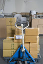 Boxes stacked on trolley view of in distribution warehouse Royalty Free Stock Images
