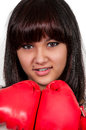 Boxing beautiful young woman wearing a pair of gloves Royalty Free Stock Photo