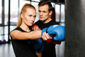 Boxing coach trains young woman Royalty Free Stock Photo