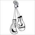 Boxing gloves hang with laces nailed to wall as a business or sport concept of a person that retires give up the fight or prepares Royalty Free Stock Photo