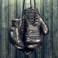 Boxing gloves old on a wooden background Stock Photography