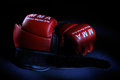 Boxing gloves red for martial arts on a black background Royalty Free Stock Photos