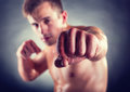 Boxing a strong man going in for on a dark background Royalty Free Stock Images