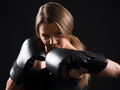 Boxing woman portrait of young beautiful girl is giving a croshe punch Stock Photography