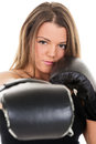 Boxing woman portrait of young beautiful girl is giving a direct punch Royalty Free Stock Photos