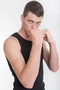 Boxing young man in a pose Royalty Free Stock Photo