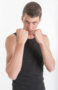 Boxing young man in a pose Royalty Free Stock Images