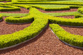 Boxwood hedges against trickling brick gravel paths public park Royalty Free Stock Photos