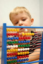 Boy with abacus Royalty Free Stock Photography