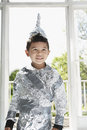Boy in aluminum foil knight costume portrait of a young standing indoors Royalty Free Stock Photos