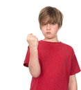 Boy is angry in red shirt Royalty Free Stock Image
