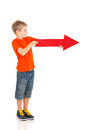 Boy arrow right holding red pointing on white background Royalty Free Stock Photos
