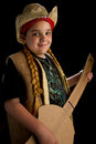 Boy as country singer young dressed with guitar and hat on black backgound Stock Image