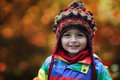 Boy in autumn park setting little wearing a warm beanie hat Royalty Free Stock Photography