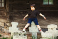 Boy awkward expression sitting cemetery cross crosses very old not actually tombs gathered exposure public space Stock Image