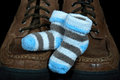 Boy baby booties on shoes striped man s worn Royalty Free Stock Images