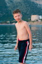 Boy on a background of sea and mountains Royalty Free Stock Photo