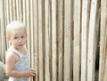 Boy on background of wooden fence planks Royalty Free Stock Photography