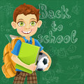Boy with backpack at the board ready to learn Stock Photos