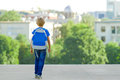 Boy with backpack on city street. Back to school, education, people, travel, leisure concept Royalty Free Stock Photo