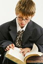 Boy in Baggy Suit Reading Royalty Free Stock Photos