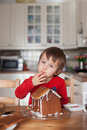 Boy baking ginger cookies for christmas at home having fun Stock Photo