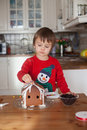 Boy baking ginger cookies for christmas at home having fun Stock Photography