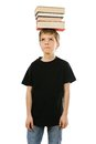 Boy balancing books on his head young with blank black t shirt ready for your design or artwork Stock Photos