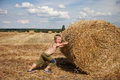Boy with bale of straw Royalty Free Stock Photo