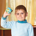 Boy with ball holding a as a globe of the world in the right hand Stock Image