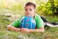Boy With The Ball On The Nature