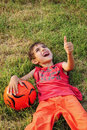 Boy with ball and thumb up Royalty Free Stock Photos