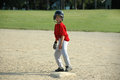 Boy on base in baseball game Royalty Free Stock Photo