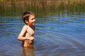 Boy bathing in river a summer day Stock Photography