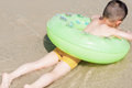 Boy on beach chinese playing sands with swim ring Royalty Free Stock Photos