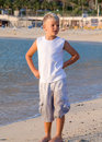 Boy at the beach looking to the left with wet trou Royalty Free Stock Photo