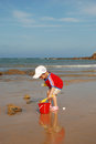 Boy on beach playing sand with spade Royalty Free Stock Photography