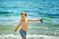 The boy on the beach with a snorkel and fins Royalty Free Stock Photo