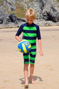 Boy on beach with volleyball Royalty Free Stock Photo