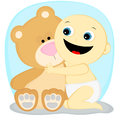 Boy with a bear little in shorts hugging teddy Stock Photo