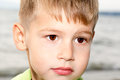 The boy with beautiful eyes on the seacoast Royalty Free Stock Photo