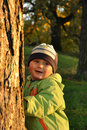 Boy behind tree Stock Photography
