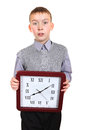 Boy with big clock isolated on the white background Royalty Free Stock Photo